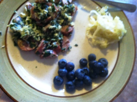 Pastured eggs with organic chicken sausage, organic spinach, blueberries and sauerkraut.